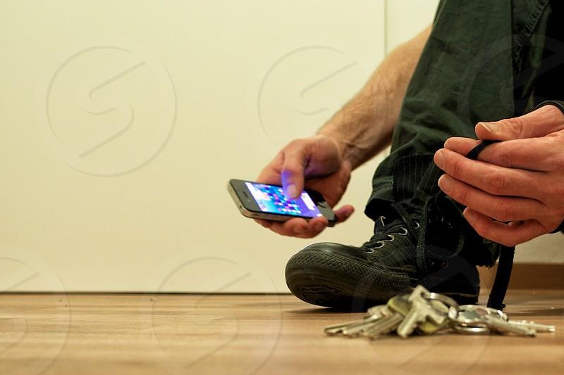 man holding iphone photo