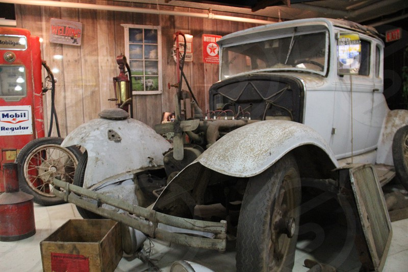 5-window ford in pieces at a antique garage photo