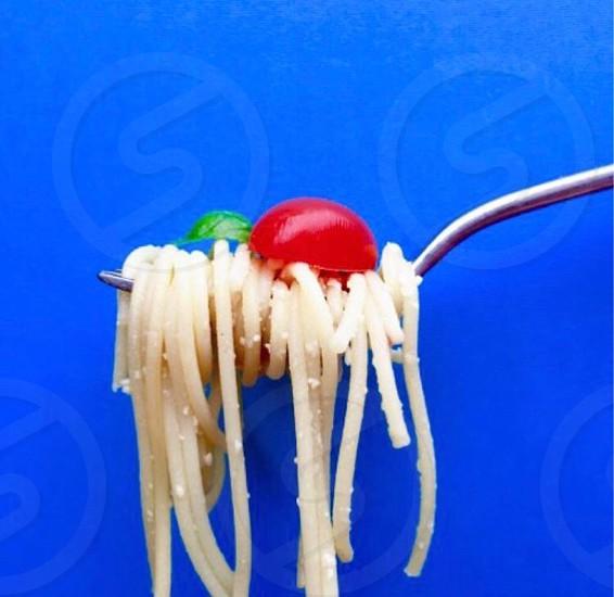 Vibrant color colorful pasta spaghetti tomato red blue photo