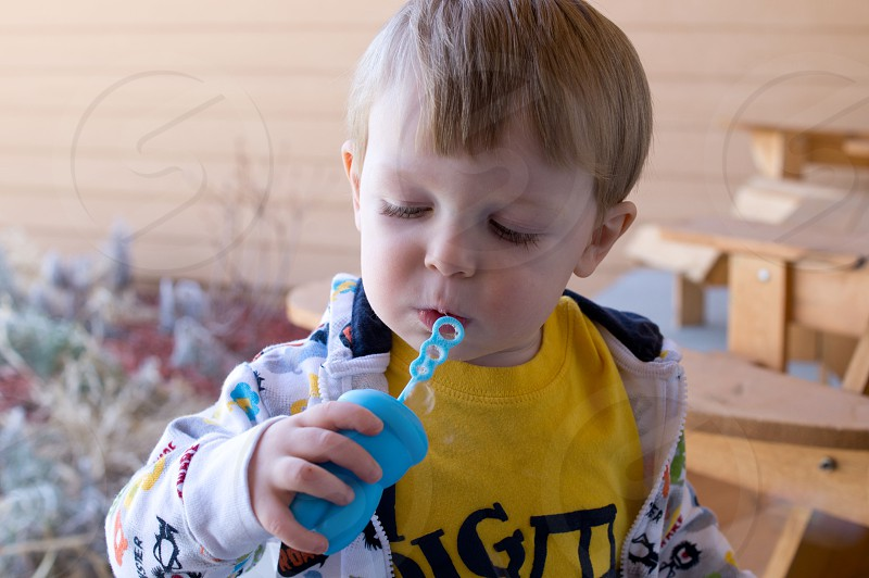 boy blowing bubbles photo