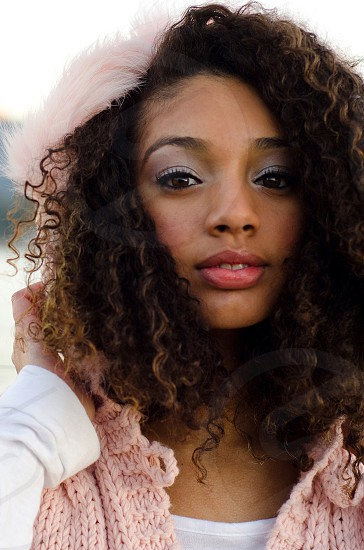 Teen mixed race curly hairlooking at camera cute brown eyes photo