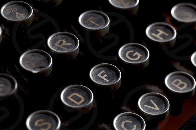 Close up photo of antique typewriter keys with dust shallow focus photo