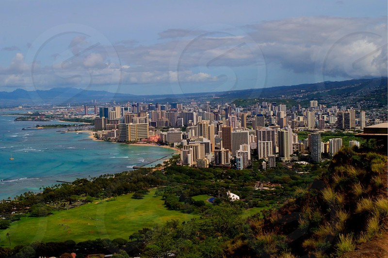 Arial photo of Waikiki beach on the Hawaiian island of Oahu. Skyscrapers volcano mountains clear blue ocean all in one.  photo