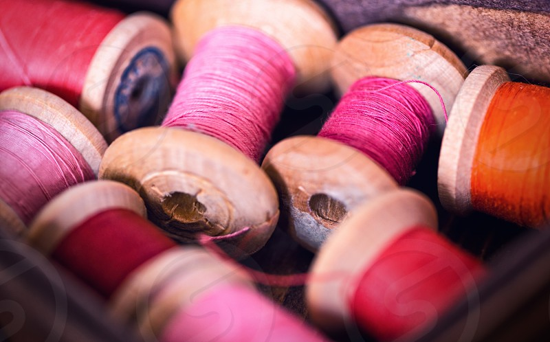threads in pink color photo