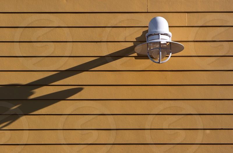 Nautical light on yellow wall photo