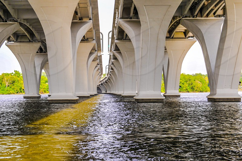 photo of white concrete bridge surrounded with water photo