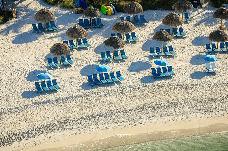 Lounge chairs on a beautiful beach.  Aerial photograph taken from a helicopter at 500 feet. photo