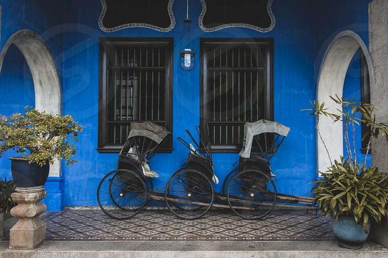 Rickshaws outside the Blue Mansion in Georgetown Malaysia. photo