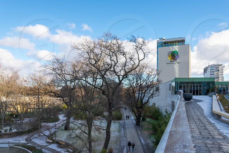 "View of Zoologischer Garten from the roof top of shopping mall called "" Bikini Berlin "" which located beside the zoo inside Tiergarten Neighborhood in Berlin Germany photo"