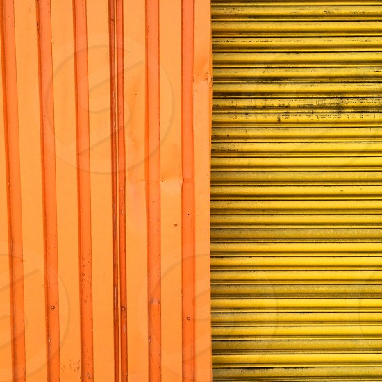yellow and orange metal surface photo