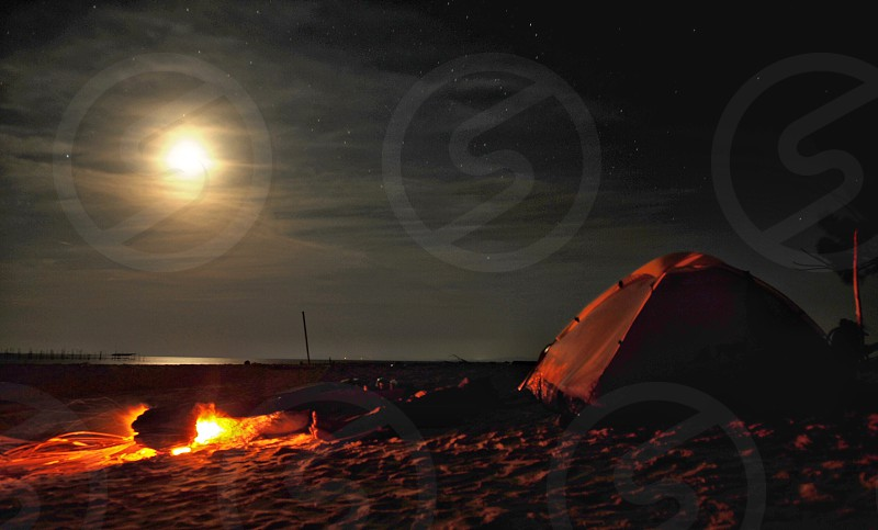 camping sea beach fullmoon sand dome tent. photo