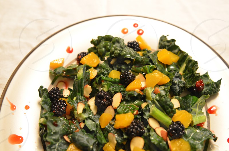 Kale salad with blackberries peaches almonds and a blackberry vinaigrette photo