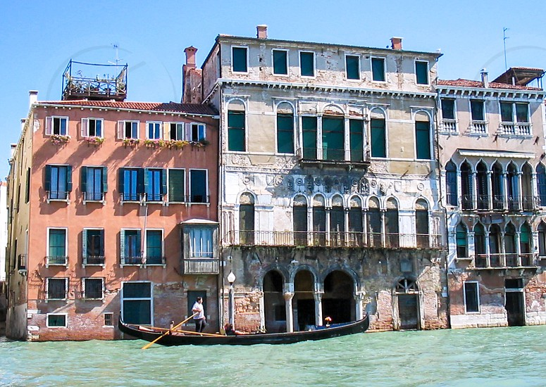 boat on venice canal photo