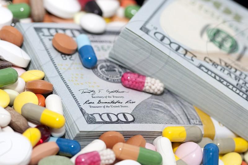 packs of dollars among various drugs photo