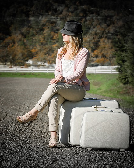 Waiting for a lift Senior Photos Having fun with a fedora and luggage. photo
