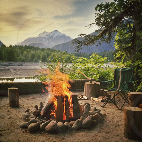 Campfire with mountain view photo