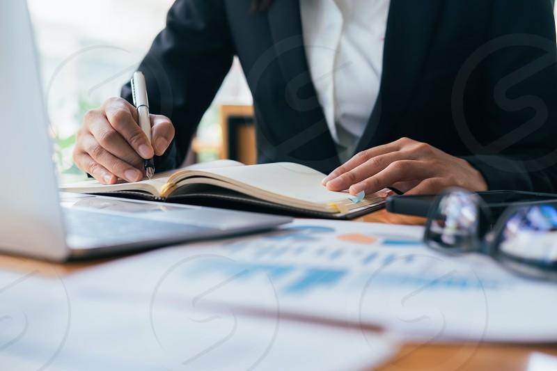 Businesswoman analyse investment marketing data. photo