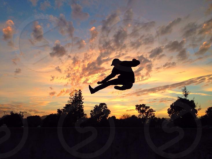 flying kick silhouette  photo