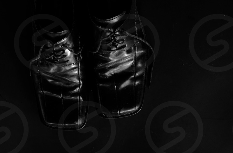 Shiny black shoes from above view. photo