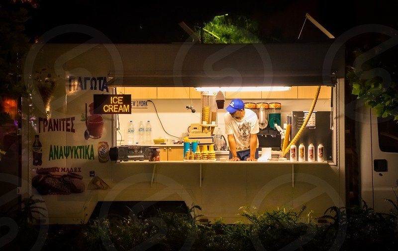 Ice Cream Food Truck Business Owner At Night Time photo