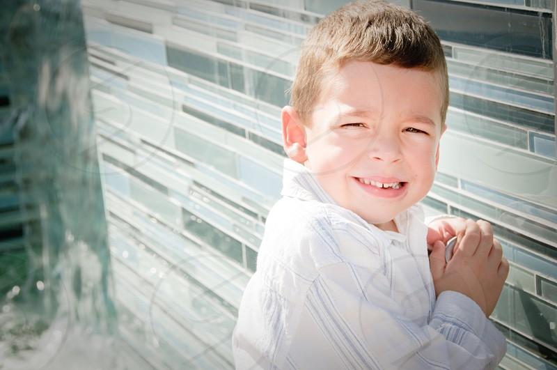 boy wearing white long sleeved shirt smiling photo