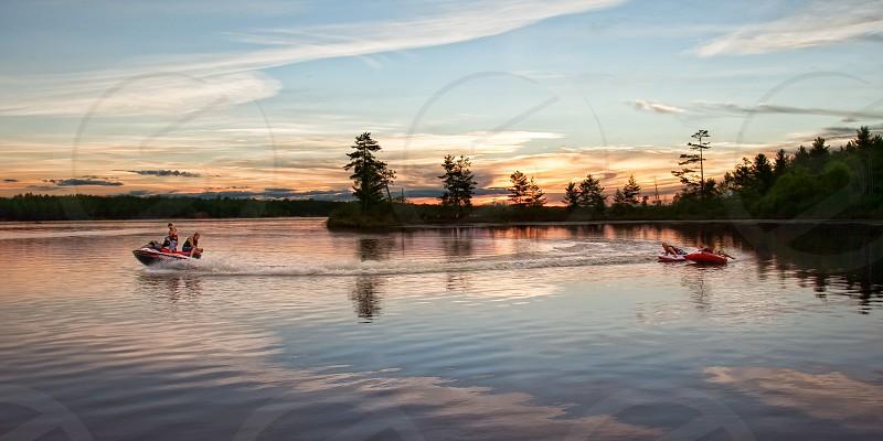 Jet skiing and tubing at sunset photo