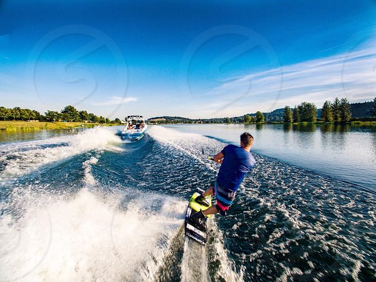 Activity wakeboarding lake blue boat  photo
