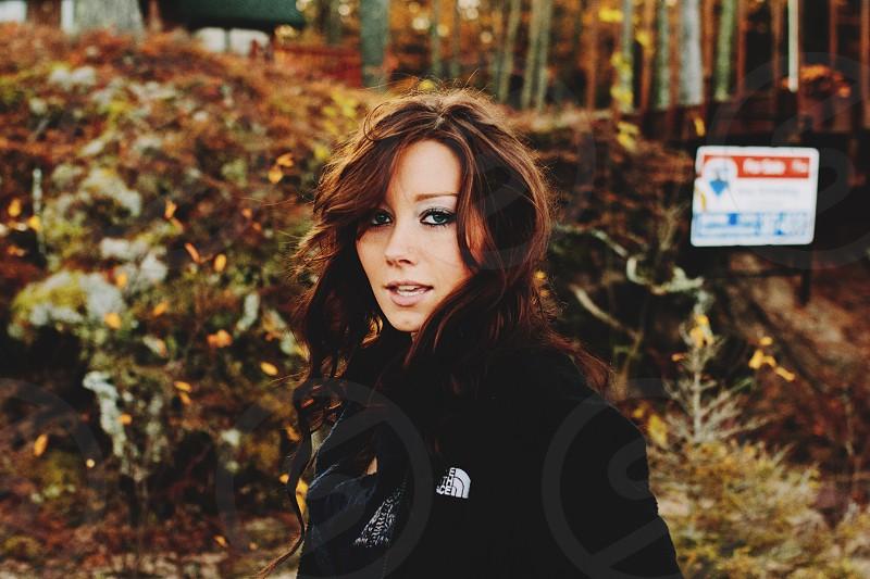 woman in black coat standing photo