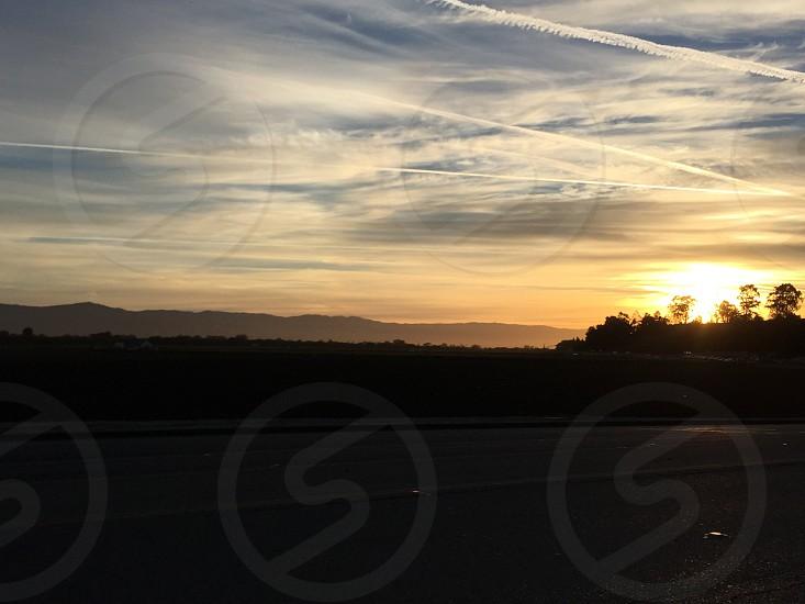 Sunrise over field in Salinas CA photo