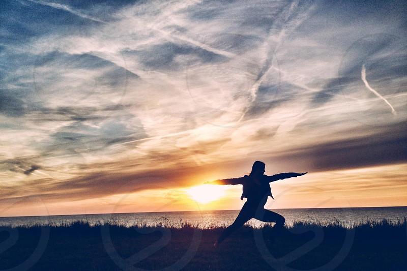 Sunset warrior pose photo