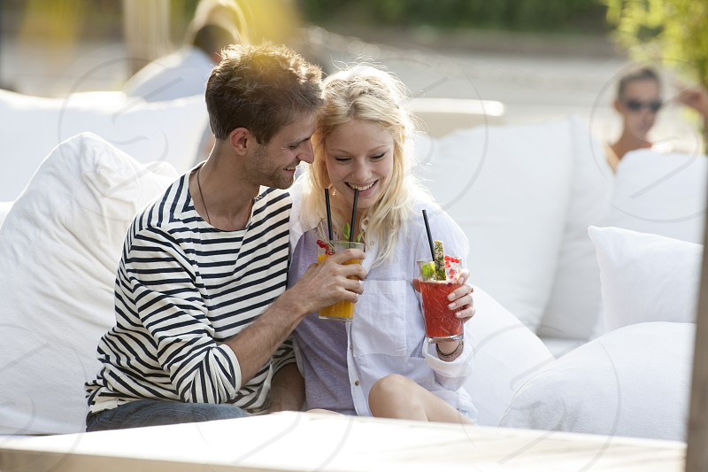 Affectionate couple relaxing outdoors in a cafe photo