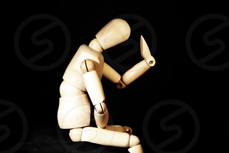 Wooden Man Thinking Pose photo