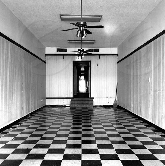 Vacant symmetry broom checkerboard black white empty  photo