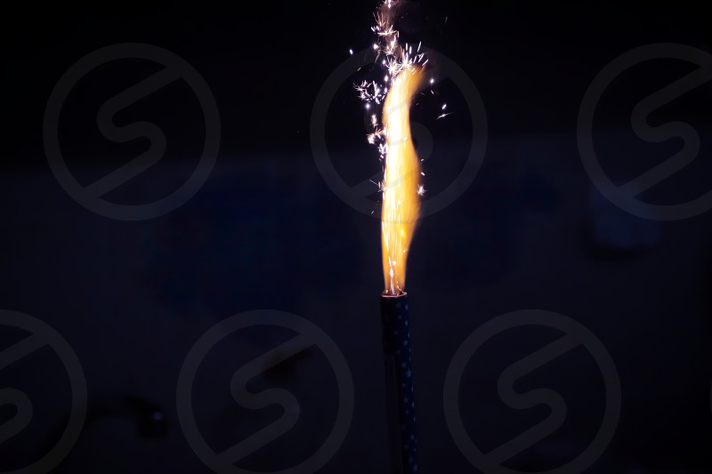 Fireworks burned in in the dark. High flame with sparks. photo