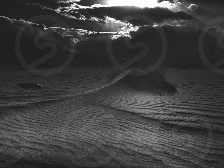 gray scale photograph of sand photo