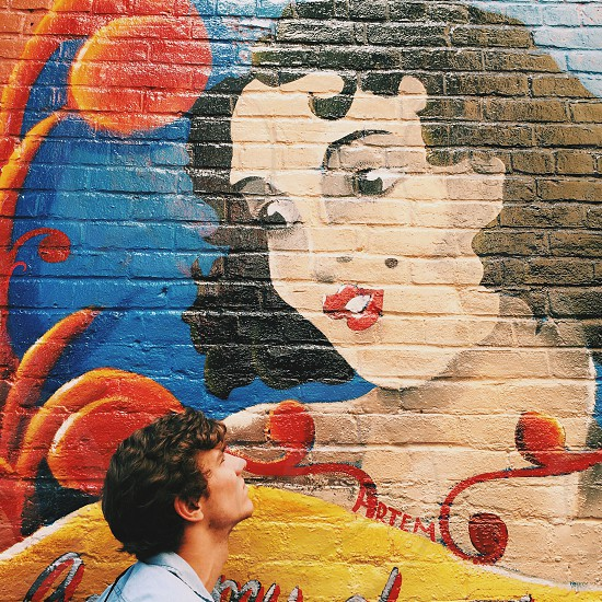 painting of woman on brick wall photo