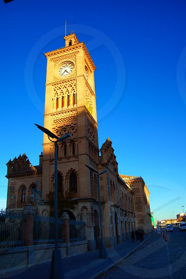 beige painted clock tower photo
