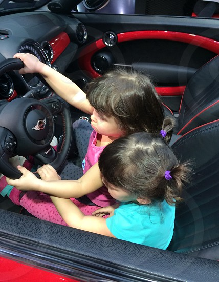 kids driving a car twins share the car mini travel family travel photo