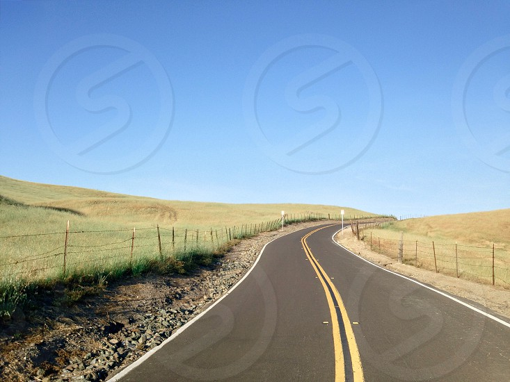 grey curved road photo