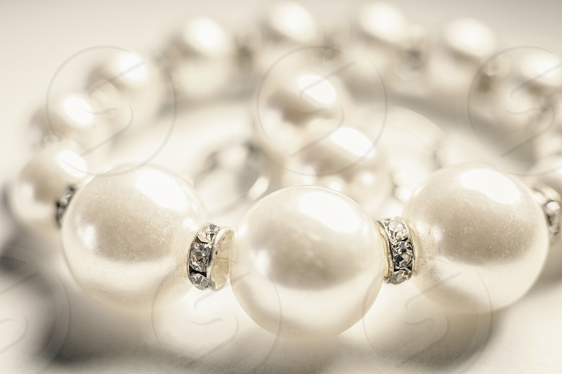 Closeup view of white necklaces and earrings.  photo