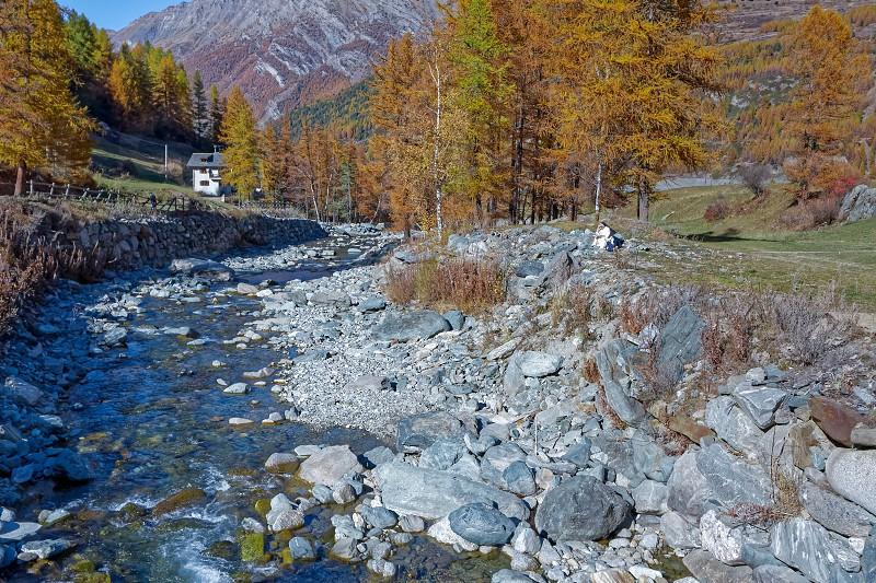 Nun Reading by the River in Cogne Gran Paradiso Park Valle d'Aosta photo