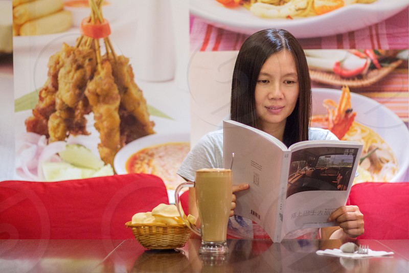 woman snacking while reading photo