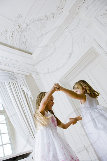 Girls in Party Dresses having fun at wedding photo