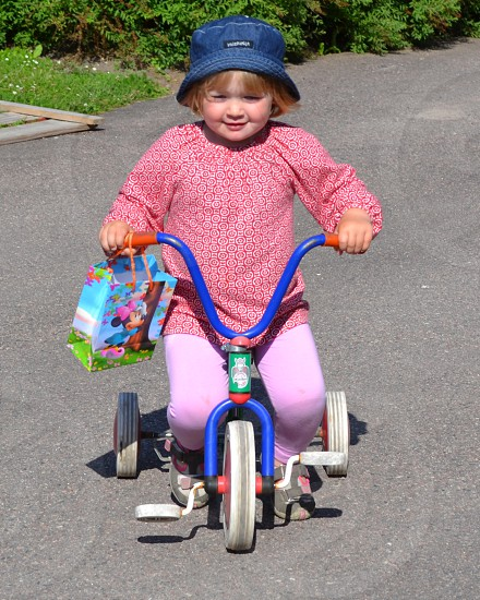 girl riding tricycle photo