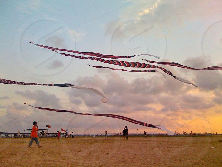 Bali kite festival beach sunset photo