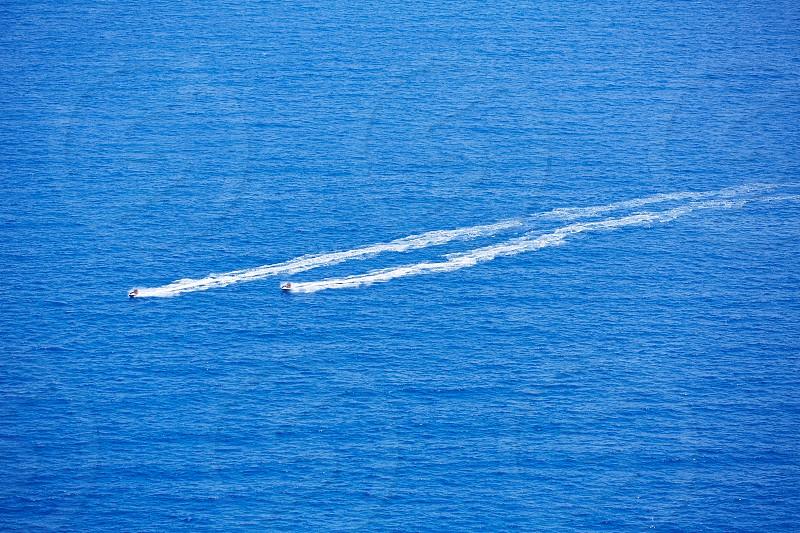 Blue sea ocean with watercrafts wash wake aerial view in Mediterranean photo