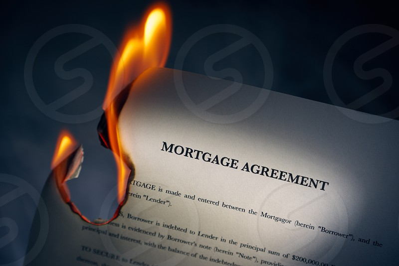 contract paper agreement fire flame loan mortgage ash banking beginnings black background burn burning burnt business close-up closeup concept copy space corporate debt destruction document estate finance freedom glowing good news heat home house indoor investment legal lend no people nobody paperwork property real estate smoke studio photo