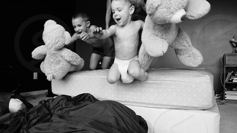 Jump kids joy fun teddy bear bedroom photo