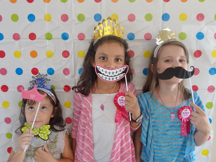 kid with kaiser mustache mask on her mouth photo