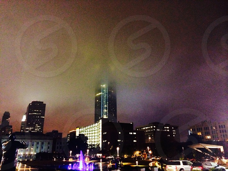 Foggy night time city scene photo